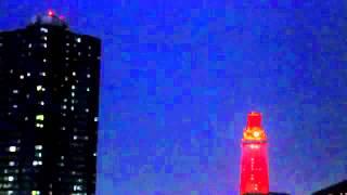 Lightning behind UT Tower