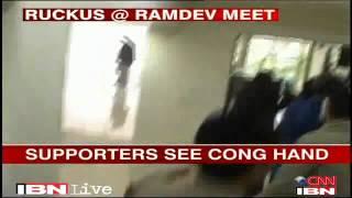 Delhi Man tries to throw ink on Baba Ramdev