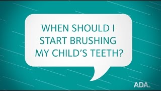 When should I start brushing my child's teeth?