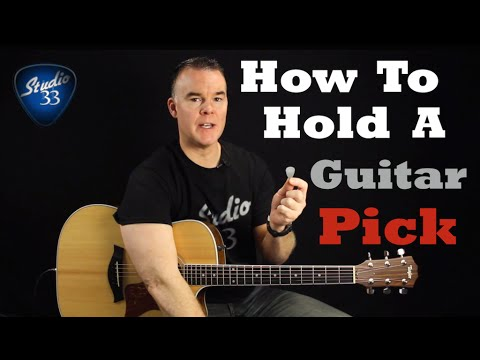 How To Properly Hold A Guitar Pick And Choose the Right One. Beginner Guitar Lesson Studio 33 Guitar
