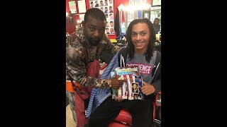 First Christian Member Helps Provide Books for Barbershops