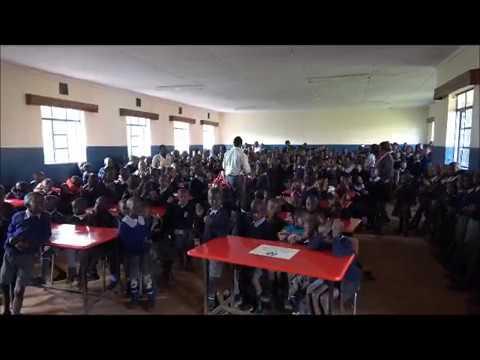 Kenyan children sing for Buckner Shoe for Orphan Souls volunteers
