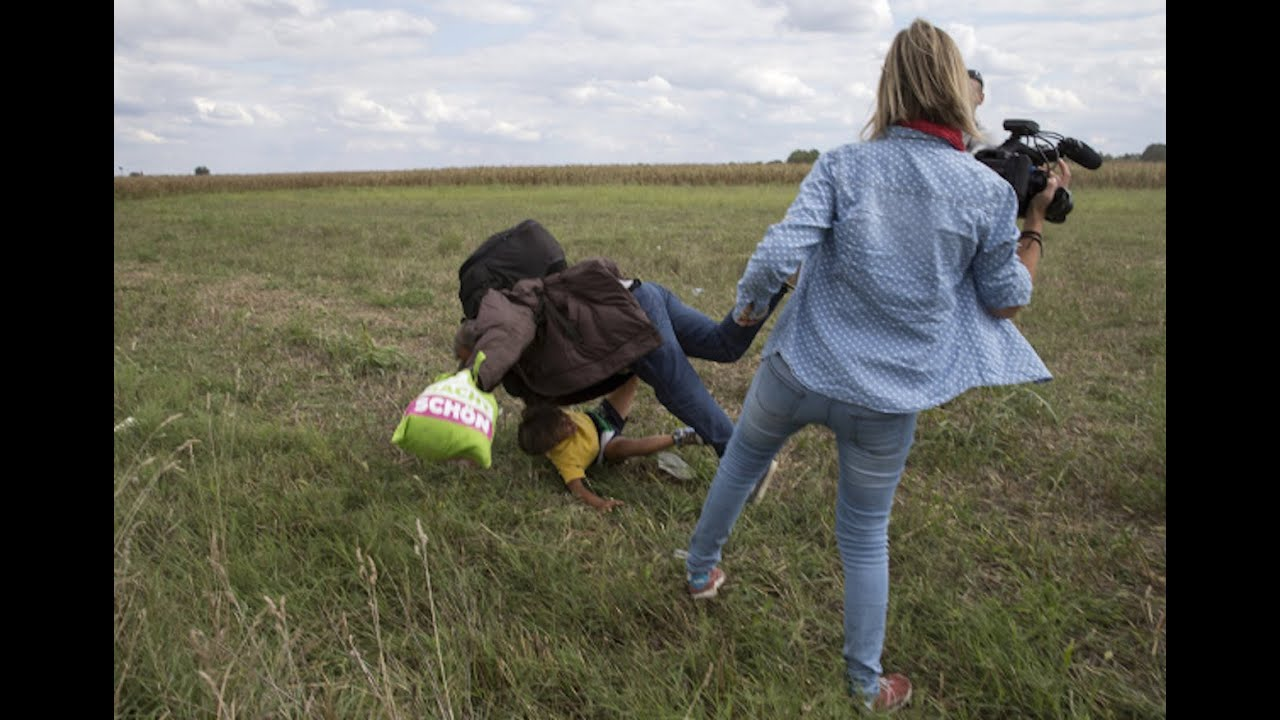 Camerawoman Caught Tripping Syrian Refugee Carrying Child thumbnail