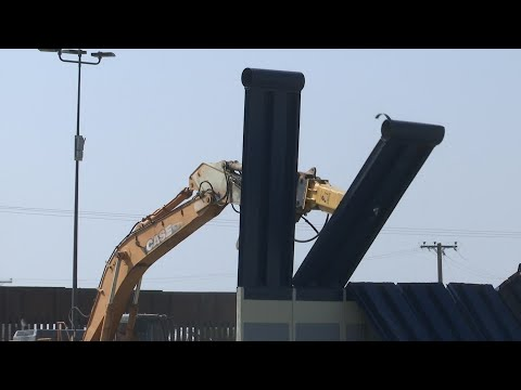 Eight prototypes of Donald Trump's border wall between San Diego and Tijuana, Mexico were demolished Wednesday.  A large hydraulic jackhammer pounded the concrete and steel panels until the slabs fell into small clouds of dust. (Feb 26)