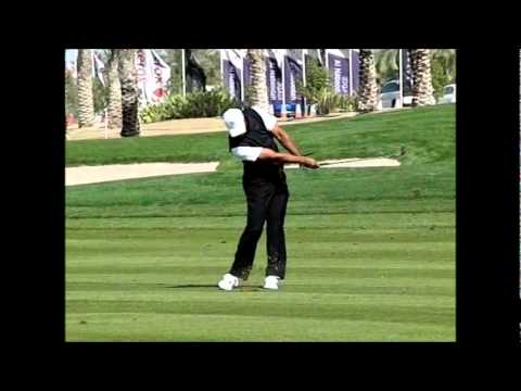 Tiger Woods playing a short iron in super slow motion.