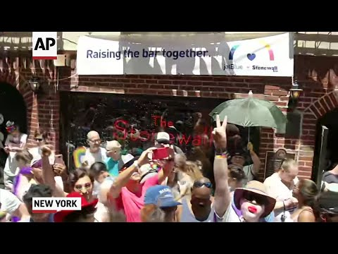 Five decades of LGBTQ pride was celebrated Sunday as crowds gathered outside New York's historic Stonewall Inn to mark the 50th anniversary of the police raid that sparked the modern-day gay rights movement and thousands marched through the city. (June 30)