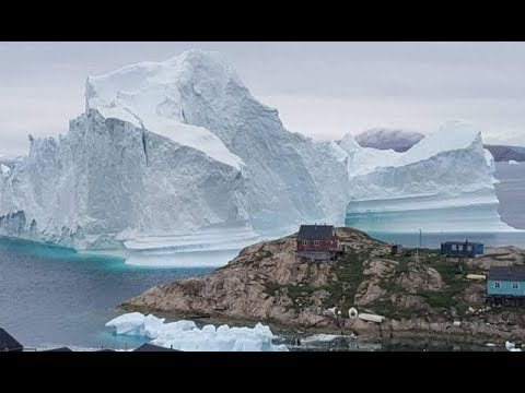 Massive iceberg threatens Greenland village as residents are evacuated