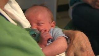 Volunteer 'cuddlers' comfort babies
