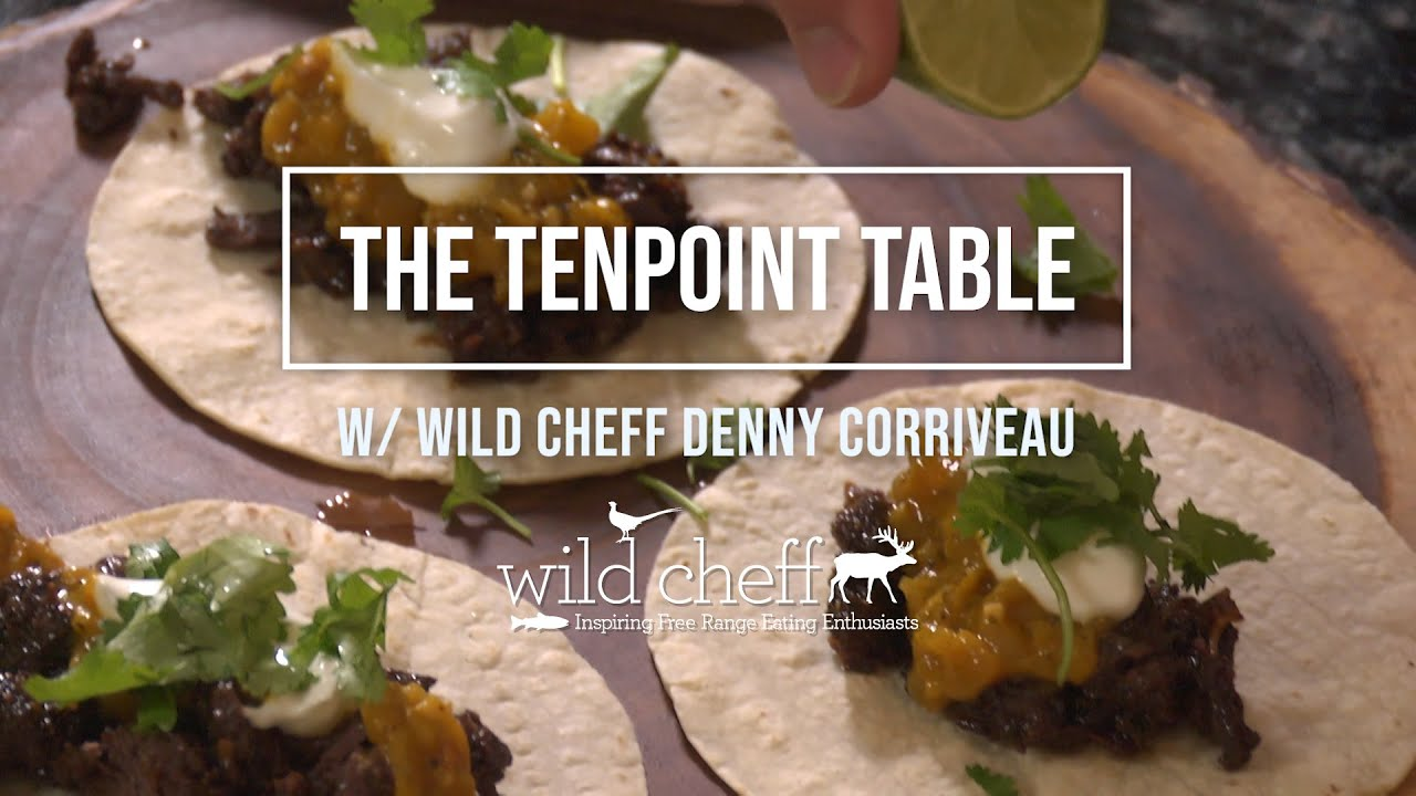 "TenPoint Crossbow Technologies is proud to partner with Celebrity Game Chef Denny Corriveau to bring you The Tenpoint Table – a video recipe series rooted in the ""field to table"" concept of sustainable living.  Ingredients and Shopping List:  2 pounds of meat, cubed (Bear, Deer, Elk, Antelope) 1 small Sweet Onion, diced 5 cloves of Garlic, minced 1-2 Tablespoons of WildCheff's Blackening Rub 2 teaspoons of Ground Cumin 2 teaspoons of WildCheff Roasted Garlic Powder 1/4-1/3 cup of Brown Sugar Juice of 1 Lime + 1 Lime 1 bottle of Pure Cane Root Beer Olive Oil Corn Tortillas A handful of Cilantro, rough chopped Sour Cream Roasted Pepper Salsa  Directions: 1. Place cubed meat into a large mixing bowl. Season meat with Blackening Rub, cumin, roasted garlic powder and brown sugar. Toss to coat evenly. Let rest for 10 minutes. 2. Heat up a Cast-Iron Dutch oven over medium-high heat. Add olive oil and warm up.  3. Once the oil is hot, add seasoned meat and sear to brown on all sides. Remove and set aside on a plate. Add oil as needed through the process.  4. To the heated pot, add diced onion and minced garlic and sauté until onion is translucent and garlic is fragrant (approx.2 minutes). 5. Add seared meat and juices back into the pot, and then add bottle of Root Beer and juice of one lime. (you should have enough Root Beer to cover the meat). 6. Bring to a boil and then back down to a simmer and cover pot. Simmer for 90-120 minutes until meat is fork-tender and can be shredded easily.  It's important to monitor periodically as stoves can differ, and you want to ensure that you have enough liquid to braise the meat through the whole cooking process.  7. When the meat is done cooking, remove from stovetop and scoop meat onto a large cutting board and shred with two forks or rough chop meat with a Shark Butcher Knife.  8. Heat up tortillas by placing on hot Cast-Iron pan or outdoor grill to lightly brown and warm through.  9. Place some of the Barbacoa meat in the center of warmed tortilla and top with your favorite salsa, followed by a dollop of sour cream and a sprinkle of fresh chopped Cilantro.  10. Squeeze a bit of lime juice over the top and enjoy with refried beans and rice."